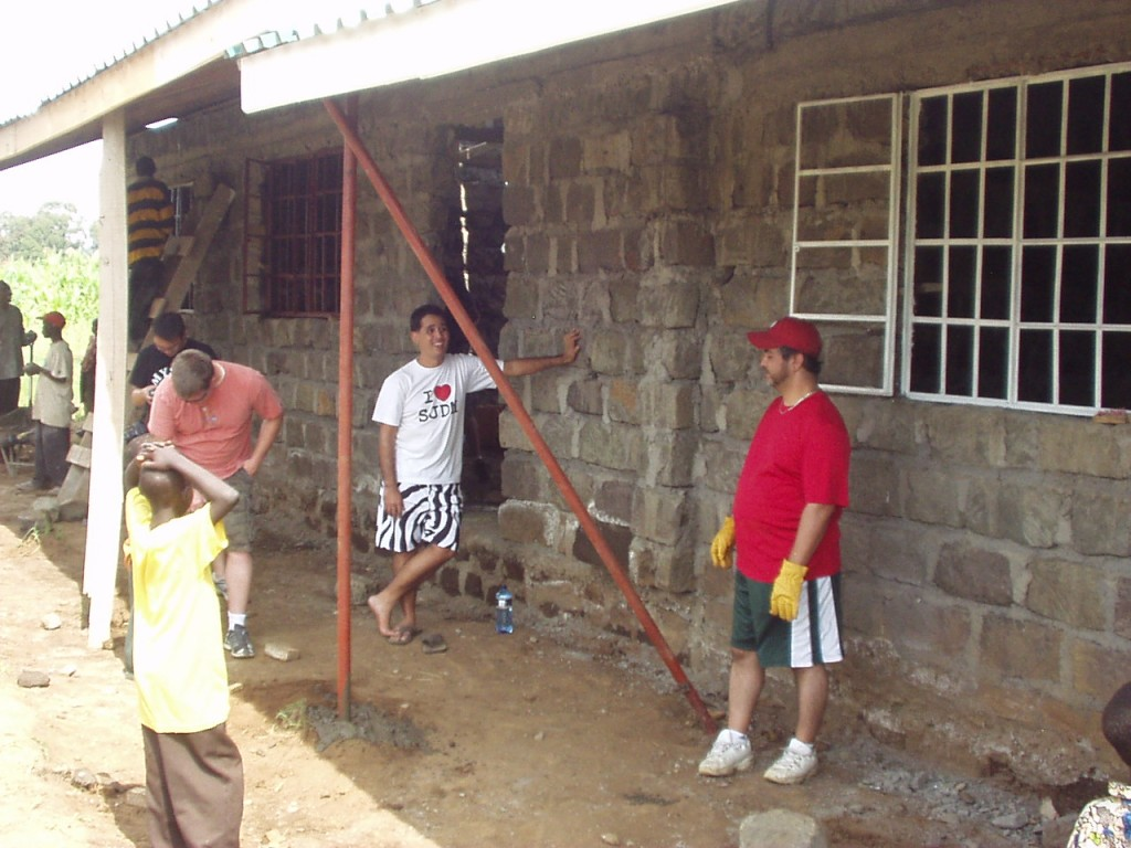 Armand, Mike and Russell waiting for building instructions in Nakuru Kenya