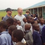 Scott and Garrett of Trust Guard wait to pass out donations in Kenya