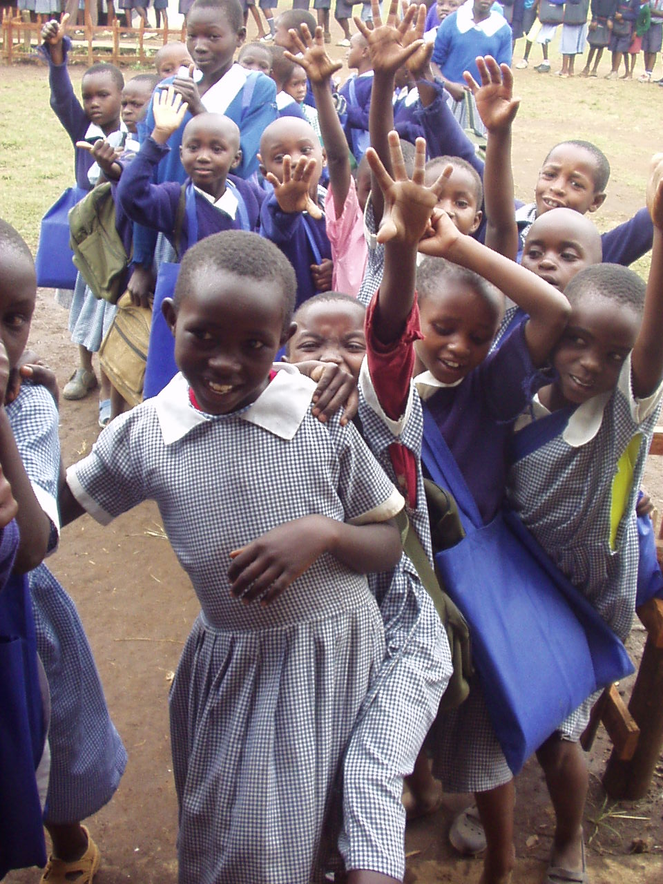 Happy students waiting to see what is inside the donation room with World Teacher Aid