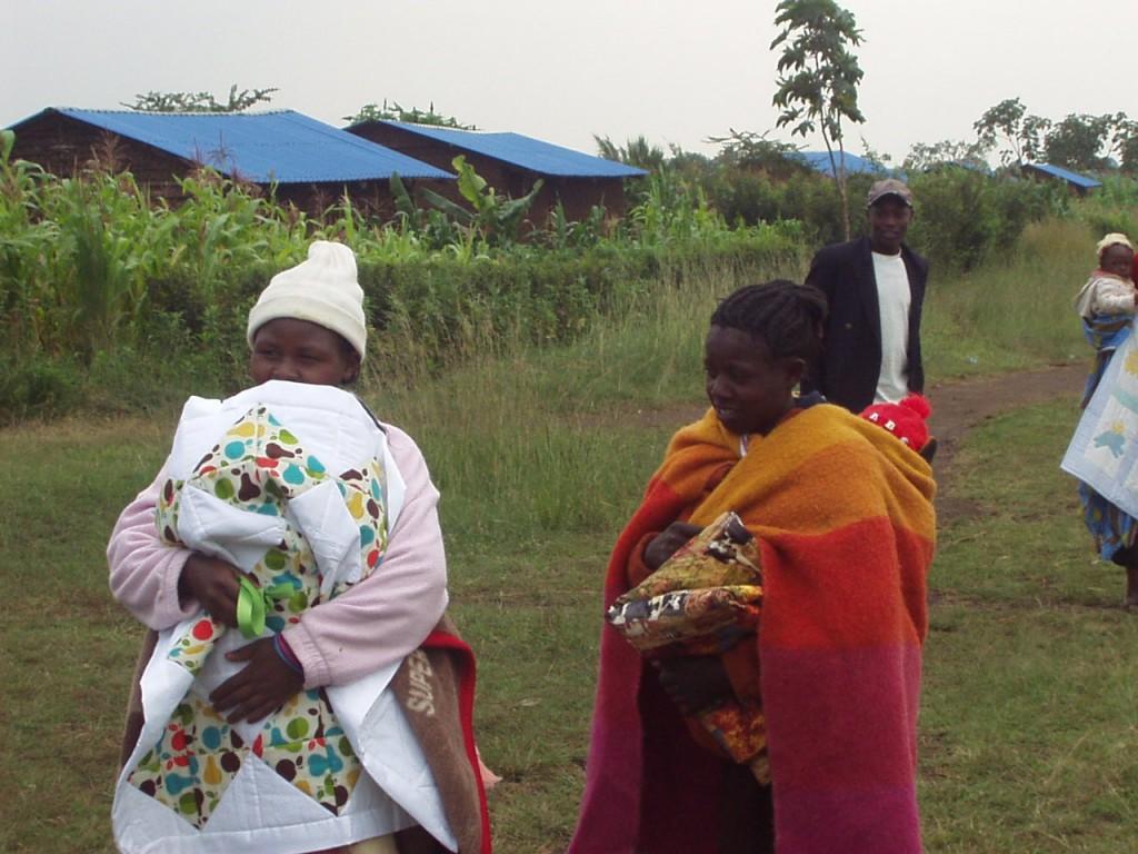Kenyan Women receiving quilts from World Teacher Aid Donors