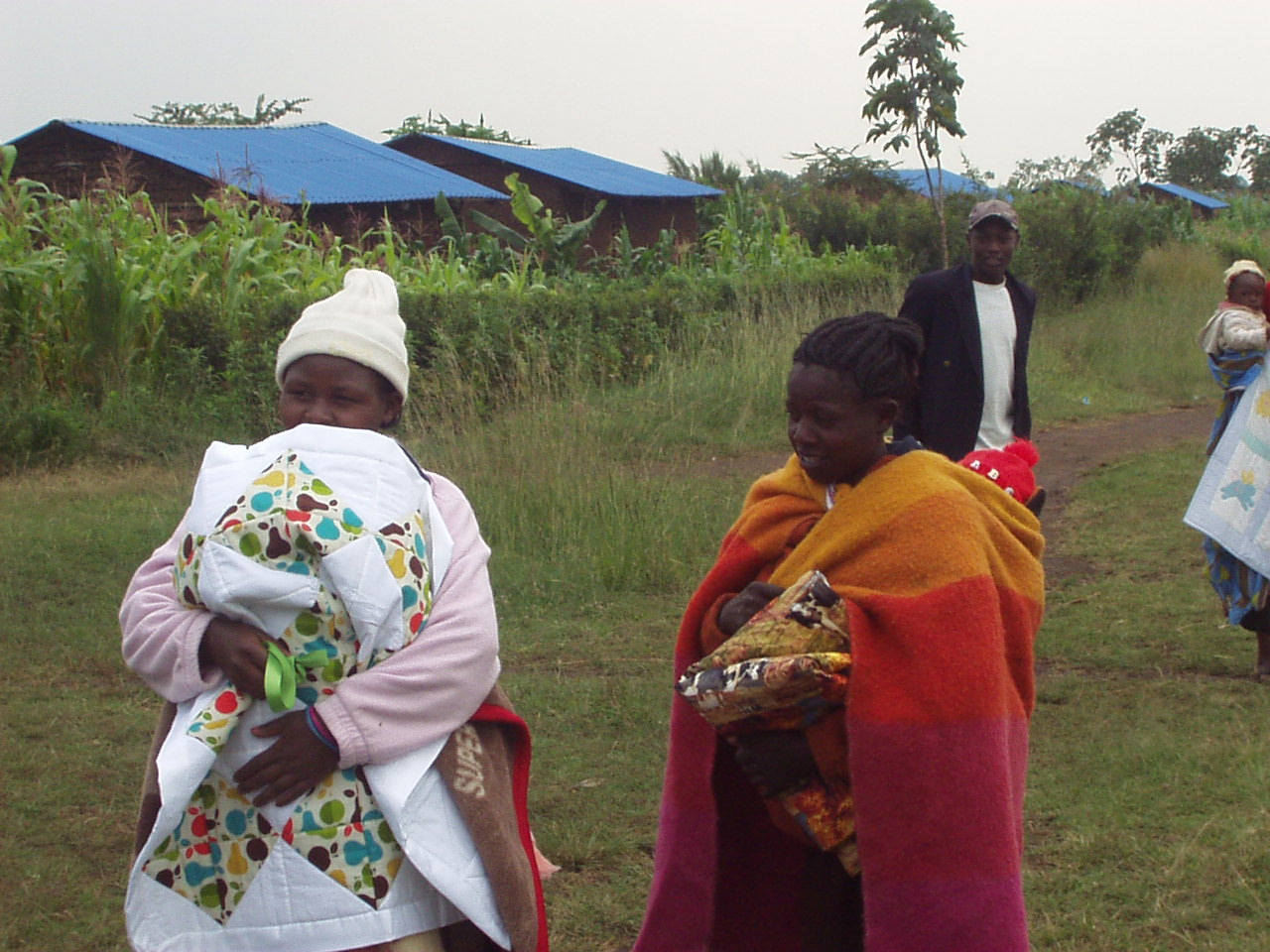 Kenyan Women receiving quilts from World Teacher Aid Donors