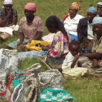 Kenyan women selling their woven grocery bag, shoulder bags