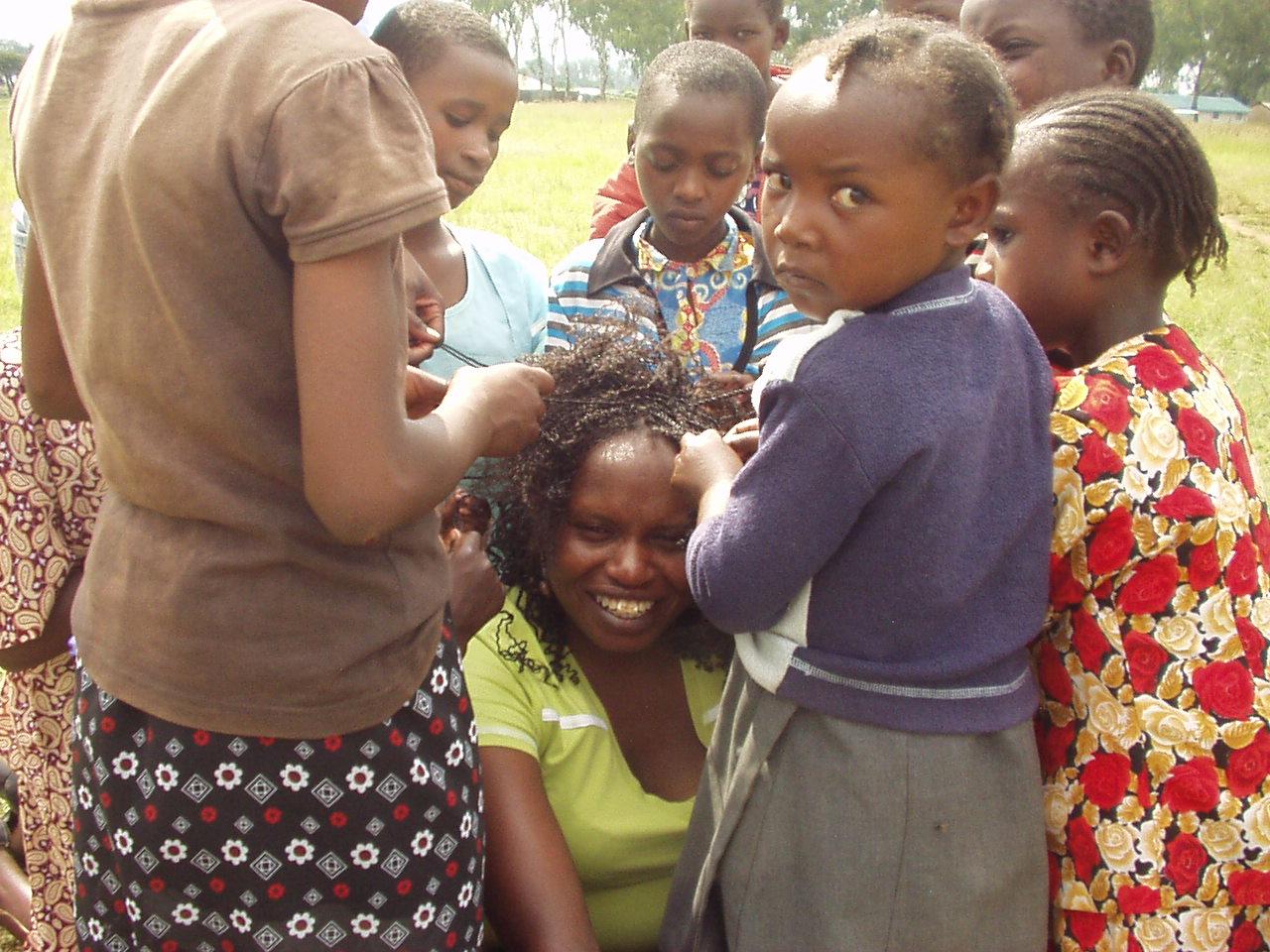 World Teacher Aid Kenya Connection Irene getting her hair done