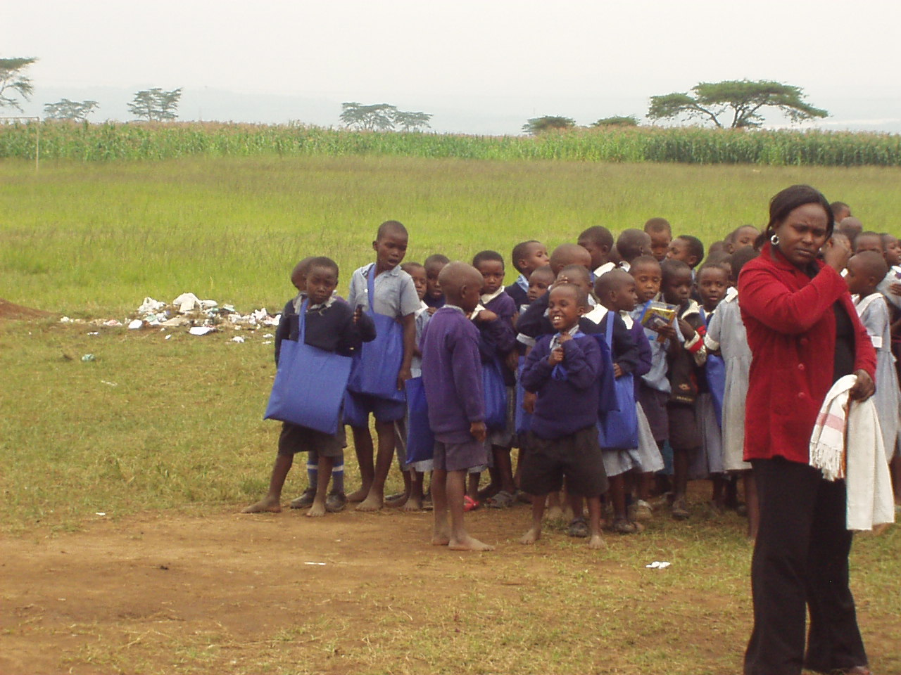 Kenyan students with their school supplies from World Teacher Aid