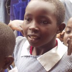Anticipation on the face of a young kenyan student for World teacher aid donations