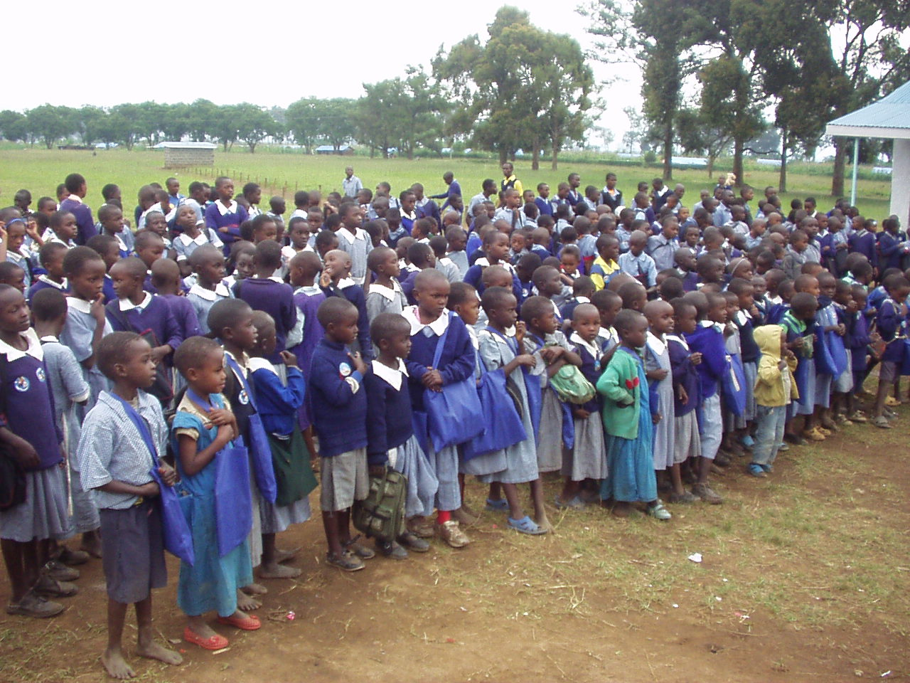 Happy Kenyan students after getting donated items and school supplies from World Teacher Aid