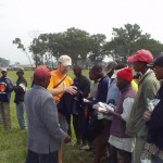 Handing out even more Solvay Concert band t-shirts to Kenyan work crew