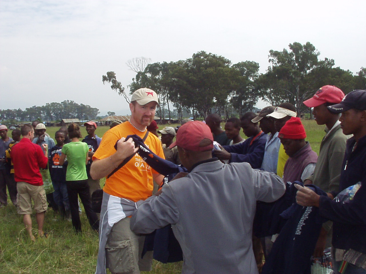 Handing out yet even more Solvay Concert band t-shirts to Kenyan work crew