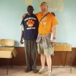 Kenyan Science Teacher and Dave Gardner on World Teacher Aid trip with new Solvay t-shirts