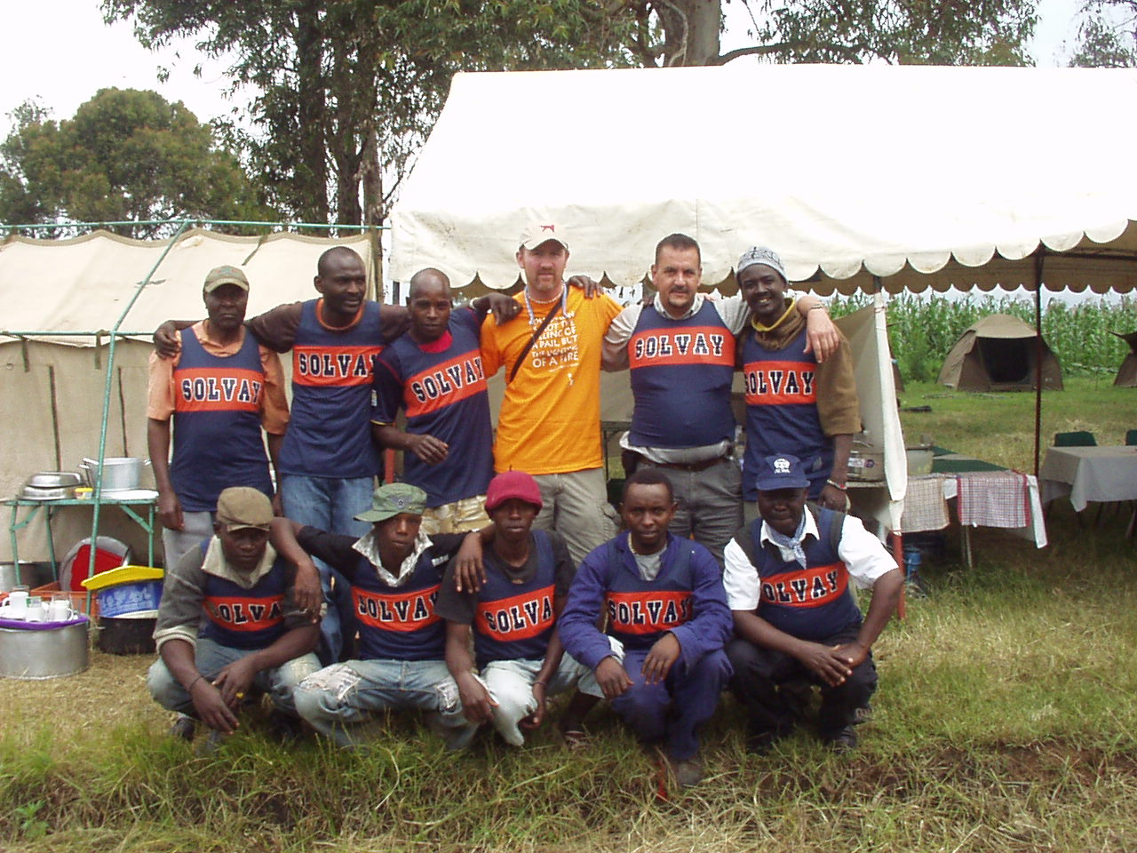Cooking crew at the Kenya World Teacher Aid school camp site with Solvay Track jersey's
