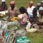 Kenyan women selling their woven grocery bag, shoulder bags